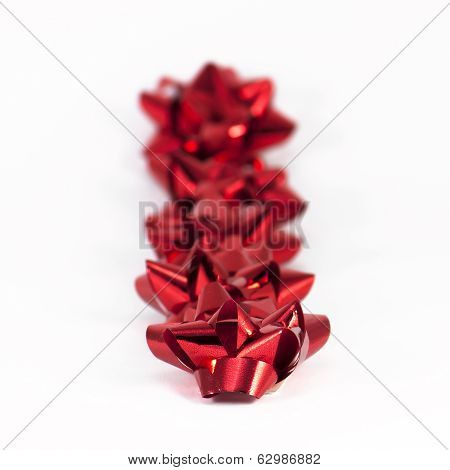 Red Gift Bows In Line