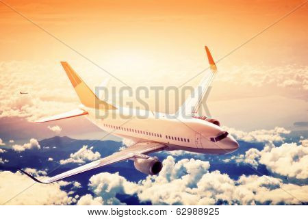Airplane in flight. A big passenger or cargo aircraft, airline above clouds. Travel, transportation, transport, business in motion.