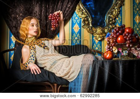Beautiful fashion model in a rich historical dress. Vintage. Luxury style.