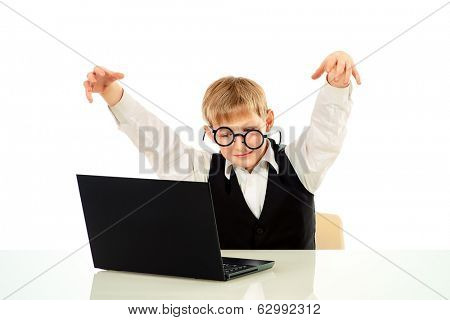 Portrait of a crazy gamer boy playing on his laptop. Education. Isolated over white.