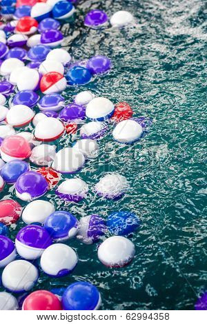 Colorful balls in water