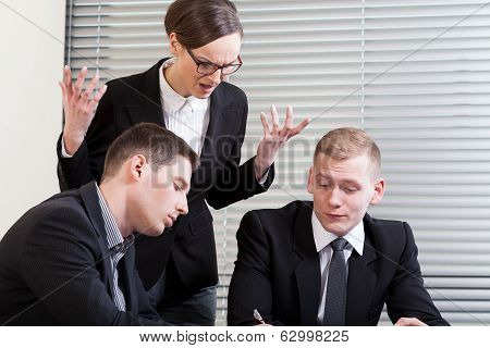 Irritated Businesswoman At Meeting
