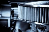 stock photo of carburetor  - performance engine air intake filter and carburetor - JPG