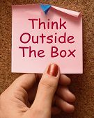 stock photo of thinking outside box  - Think Outside The Box Means Different Unconventional Thinking - JPG
