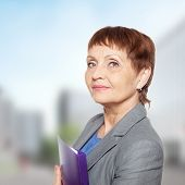 pic of 55-60 years old  - attractive woman 50 years old with a folder for documents - JPG