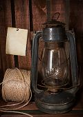 stock photo of kerosene lamp  - Old kerosene stove and a roll of twine on a rustic background in vintage style - JPG