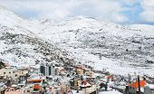 picture of golan-heights  - Mount Hermon and the Druze village of Majdal Shams in the Golan Heights in Northern Israel covered in snow - JPG
