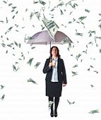 businesswoman with umbrella and money rain