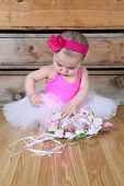 image of bodysuit  - Baby ballerina wearing a white tutu and pink bodysuit