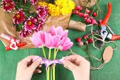 image of card-making  - Female hands composing beautiful bouquet - JPG