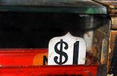 stock photo of cash register  - Antique cash register sign reads one dollar - JPG