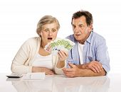 Senior couple with money