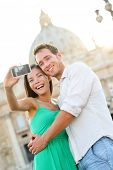 Tourists couple selfie by Vatican city and St. Peter's Basilica church in Rome. Happy travel woman a