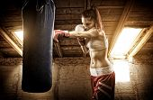 foto of attic  - Young woman boxing workout on the attic - JPG