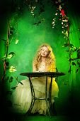 foto of loach  - Lovely girl in a lush white dress sitting at the table under a floral arch over green background - JPG