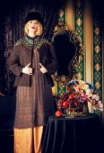 Portrait of a beautiful fashion model in a rich historical costume. Fur clothing. Vintage. Luxury st
