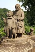 stock photo of grandma  - Monument Grandma with children - JPG