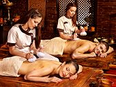 stock photo of panchakarma  - Couple  having oil Ayurveda spa treatment - JPG