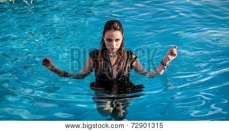 Wet Woman In Black Dress In A Swimming Pool