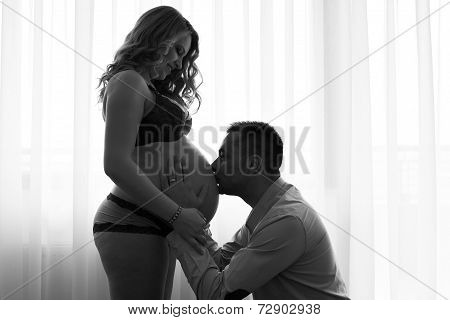 Black And White Pregnant Woman And Her Husband