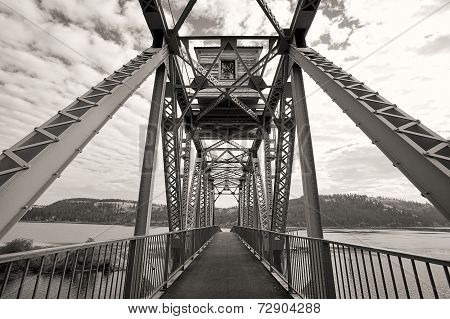 B&w Bike Bridge Over Lake.