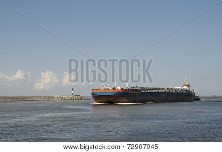 Barge with tugboat transporting sand