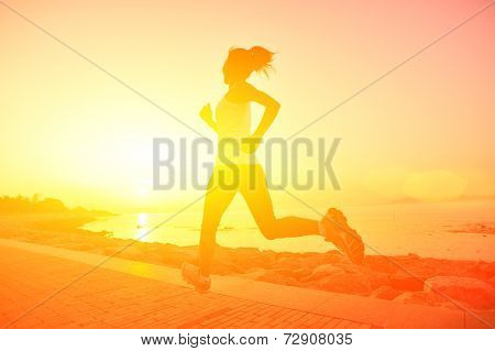 Runner athlete running at seaside.