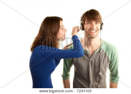 Woman Interrupts Man With Headphones