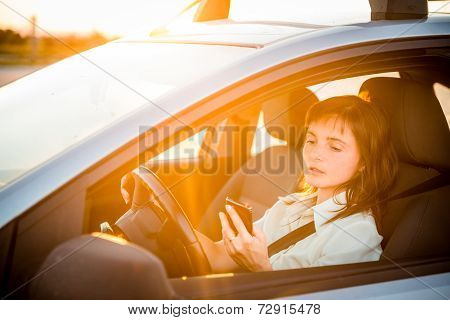 Driving car and looking in phone