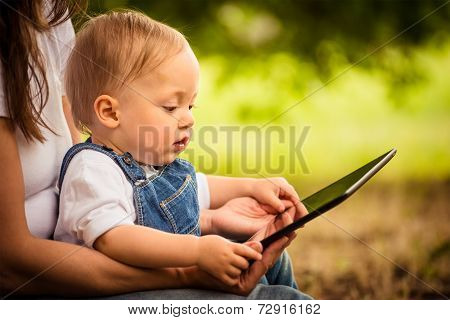 Mother, child and tablet