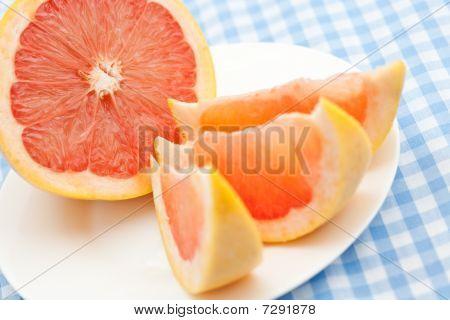 Three Pink Grapefruit Segments