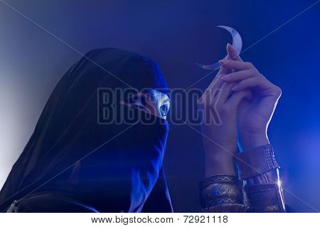 Beautiful Young Muslim Girl Holding A Moon Symbol, Spirituality