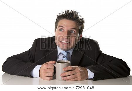 Addicted Businessman In Suit And Tie Holding Cup Of Coffee As Maniac In Caffeine Addiction