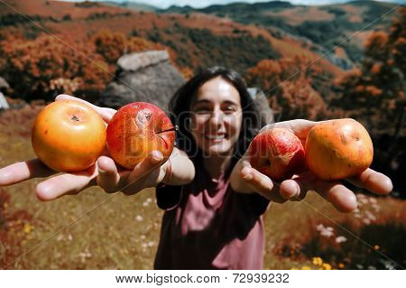 Smiling Girl Holding Apples In Her Hand
