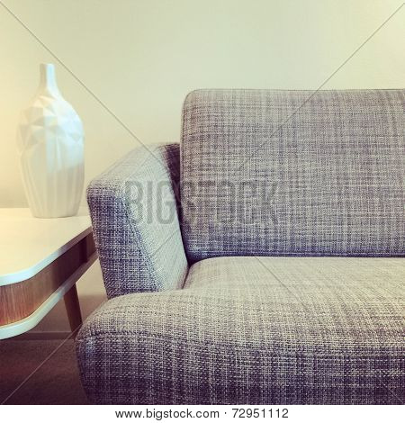 Gray Sofa And Vase On A Coffee Table