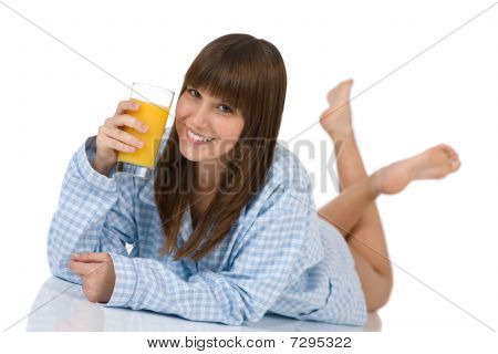 Female Teenager With Healthy Orange Juice