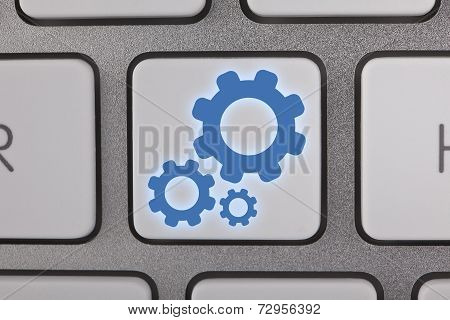 Cogwheel on Computer Keyboard