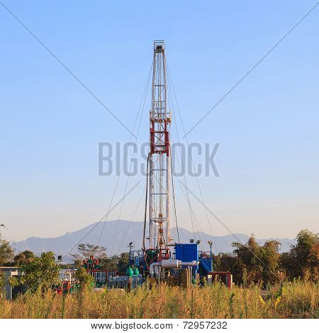 Oil Land Drilling Rig Working In The Field