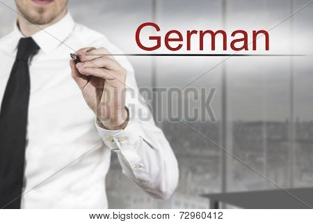 Businessman Writing German Translation In The Air