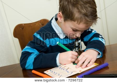 Writing And Drawing Boy