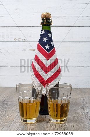 Bottle Of Beer Surrounded With An American Flag