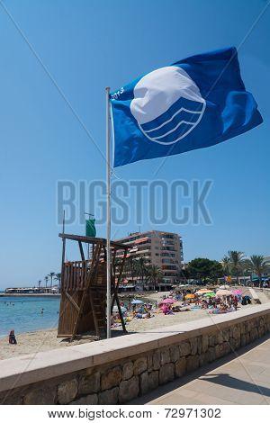 Blue Flag On Beach