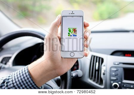 Iphone 5S With Google Maps In The Hand Of Driver