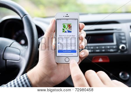 Iphone 5S With Google Maps In The Hands Of Driver