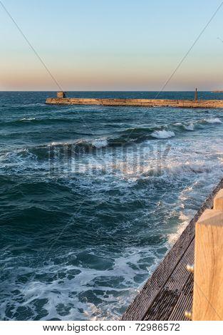 Foamy waves at the boardwalk