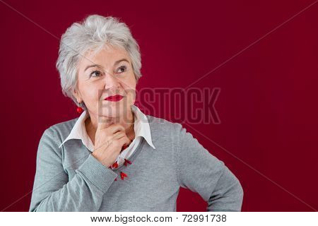 Portrait of thoughtful elderly woman
