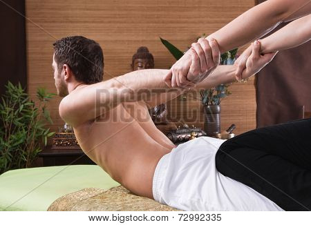 Thai woman making massage to a man