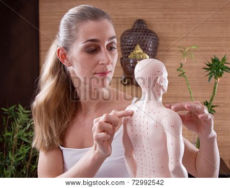 Woman showing acupuncture points