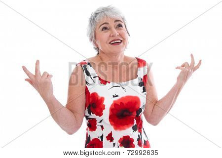 Isolated portrait of inquiring senior woman in summer dress over white background.