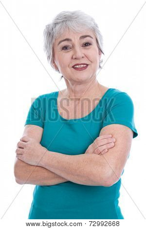 Happy senior woman standing with arms crossed